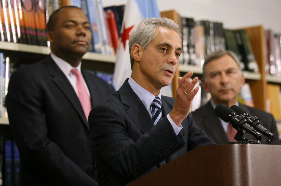 Photo -   Chicago Mayor Rahm Emanuel, center, is flanked by Chicago Public Schools CEO Jean-Claud Brizard, left, and school board president David Vitale during a news conference after the teachers union House of Delegates voted to suspend their strike Tuesday, Sept. 18, 2012, in Chicago. The city's teachers agreed to return to the classroom after more than a week on the picket lines, ending a spiteful stalemate with Emanuel that put teacher evaluations and job security at the center of a national debate about the future of public education. (AP Photo/Charles Rex Arbogast)