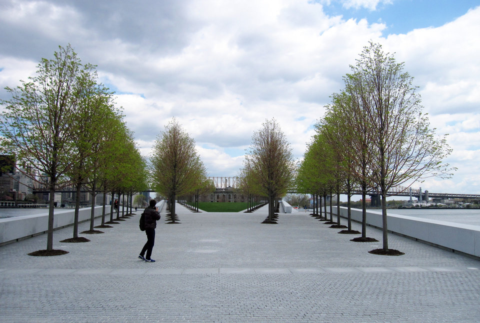 Photo - This May 1, 2014 photo shows a visitor taking pictures at Franklin D. Roosevelt Four Freedoms Park, located on Roosevelt Island in New York City, with the Ed Koch Queensborough Bridge in the distance. The park, designed by renowned architect Louis I. Kahn, is considered an architectural masterpiece and offers scenic views of the city. (AP Photo/Beth J. Harpaz)