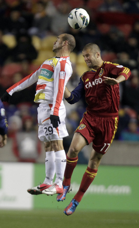 Photo -   Herediano's Esteban Ramirez, left, and Real Salt Lake's Chris Wingert jump for a header during a CONCACAF Champions League matchup in Sandy, Utah, Tuesday, Oct. 23, 2012. (AP Photo/Deseret News, Brian Nicholson) SALT LAKE TRIBUNE OUT PROVO OUT MAGS OUT