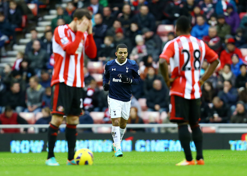 Tottenham Hotspurs\' Aaron Lennon, center, celebrates his goal during their English Premier League soccer match against Sunderland at the Stadium of Light, Sunderland, England, Saturday, Dec. 29, 2012. (AP Photo/Scott Heppell)