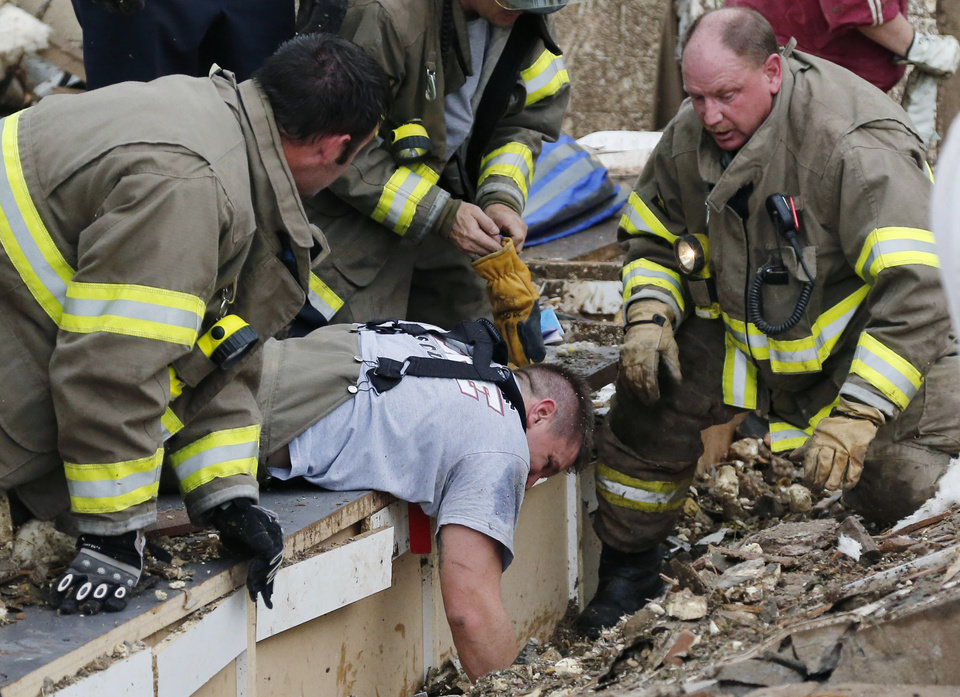 Rescue workers dig through the rubble of a collapsed wall at the Plaza Tower Elementary School to free trapped students in Moore, Okla., following a tornado Monday, May 20, 2013. A tornado as much as a mile (1.6 kilometers) wide with winds up to 200 mph (320 kph) roared through the Oklahoma City suburbs Monday, flattening entire neighborhoods, setting buildings on fire and landing a direct blow on an elementary school. (AP Photo/Sue Ogrocki) ORG XMIT: OKSO122