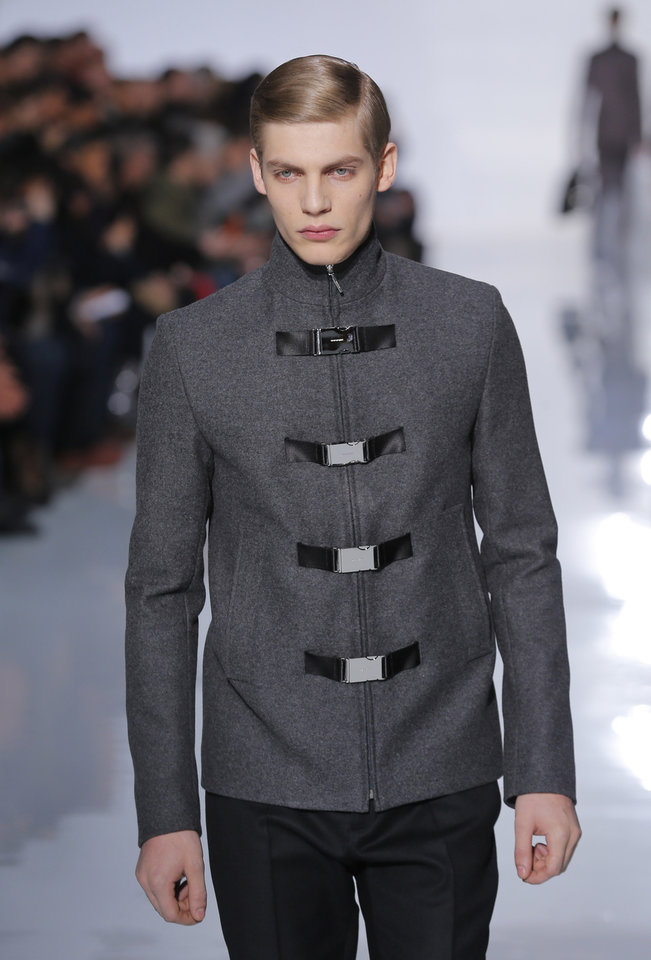 A model wears a creation by Belgian fashion designer Kris Van Assche for Christian Dior's fall-winter 2013/2014 men's fashion collection, presented in Paris, Saturday, Jan.19, 2013. (AP Photo/Jacques Brinon)