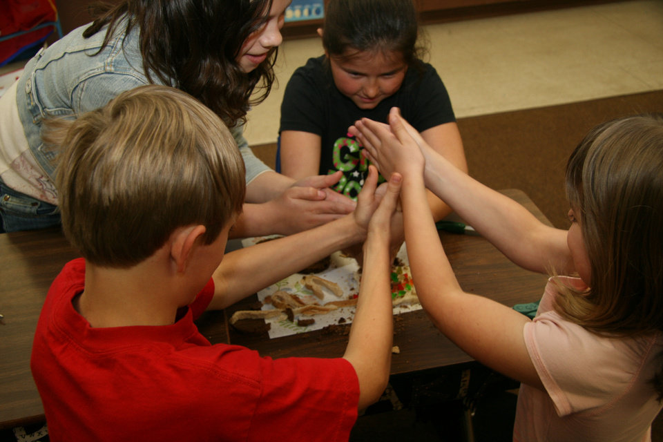 Photo - Third-graders at Glenwood Elementary School in Enid work on an experiment developed by the Oklahoma Energy Resources Board. Photo provided  Breanne Gaynor