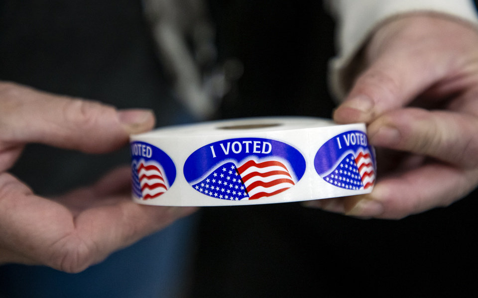 Photo - Stickers are prepared for voters after they cast their ballots at the United Methodist Church of the Good Shepherd in Yukon, Okla. on Tuesday, Nov. 3, 2020. [Chris Landsberger/The Oklahoman]