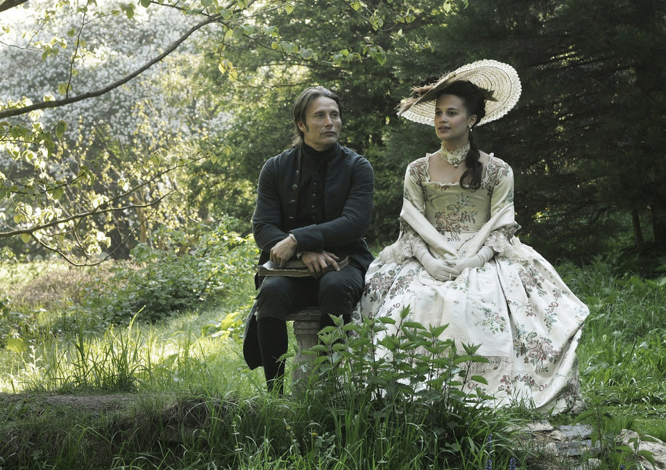 "This film image released by Magnolia Pictures shows Mads Mikkelsen, left, and Alicia Vikander in a scene from ""A Royal Affair."" The film was nominated for an Academy Award for best foreign picture on Thursday, Jan. 10, 2013.  The 85th Academy Awards will air live on Sunday, Feb. 24, 2013 on ABC. (AP Photo/Magnolia Pictures) ORG XMIT: NYET464"