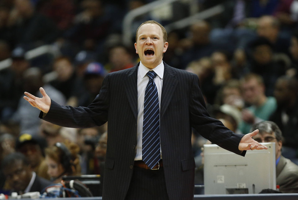 Photo - Detroit Pistons head coach Lawrence Frank reacts in the first half of an NBA basketball game against the Atlanta Hawks, Wednesday, Dec. 26, 2012, in Atlanta. (AP Photo/John Bazemore)