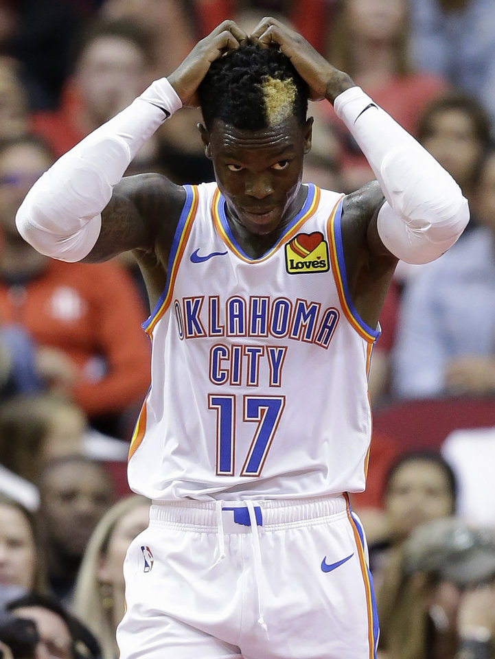 Photo - Oklahoma City Thunder guard Dennis Schroder reacts after committing an offensive foul during the second half of an NBA basketball game against the Houston Rockets, Monday, Oct. 28, 2019, in Houston. (AP Photo/Eric Christian Smith)