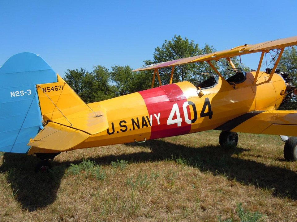 A Stearman biplane sits at the Will Rogers & Wiley Post Fly-In at Oologah. Photo by Matthew Maupin