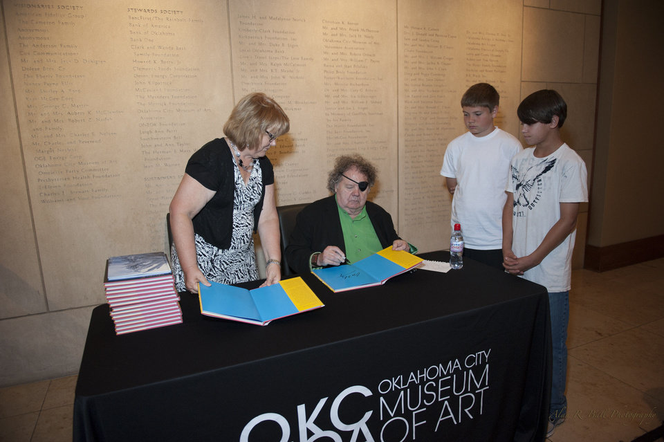 Famed glass artist Dale Chihuly signs copies of his books during his June 24 visit to the Oklahoma City Museum of Art. Chihuly gave an invitation-only lecture at the museum, followed by a book signing for museum members. Photo provided by the Oklahoma City Museum of Art. <strong></strong>
