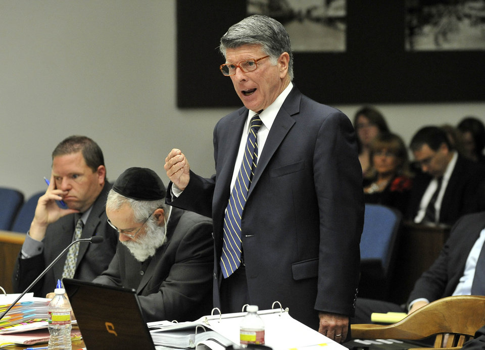Photo -   Defense attorney John D. Barnett, who is representing Fullerton police officer Manuel Ramos, in the beating death of Kelly Thomas, a homeless man in Fullerton, cross-examines a witness during a preliminary hearing in Santa Ana, Calif., Monday, May 7, 2012. Ramos, a 10-year-veteran of the department, is accused of second-degree murder and involuntary manslaughter. (AP Photo/The Orange County Register, Joshua Sudock, Pool)