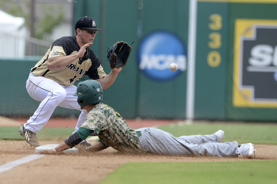 Photo - Southeastern Louisiana's Jacob Seward bottom, safely steals third from under Bryant's John Mullen on Saturday, May 31, 2014, during the first round of an NCAA college baseball regional tournament in Baton Rouge, La. (AP Photo/The Baton Rouge Advocate, Hilary Scheinuk) NO SALES; MAGAZINES OUT; INTERNET OUT;TV OUT; NO FOREIGNS. LOUISIANA BUSINESS INC. OUT (INCLUDING GREATER BATON ROUGE BUSINESS REPORT; 225; 10/12; INREGISTER; LBI CUSTOM MAGS OUT/  INTERNET OUT/ ONLINE OUT/ NO SALES/  TV OUT/  FOREIGN OUT/ LOUISIANA BUSINESS INC. OUT (INCLUDING GREATER BATON ROUGE BUSINESS REPORT, 225, 10/12, INREGISTER, LBI CUSTOM PUBLICATIONS) MANDATORY CREDIT THE ADVOCATE