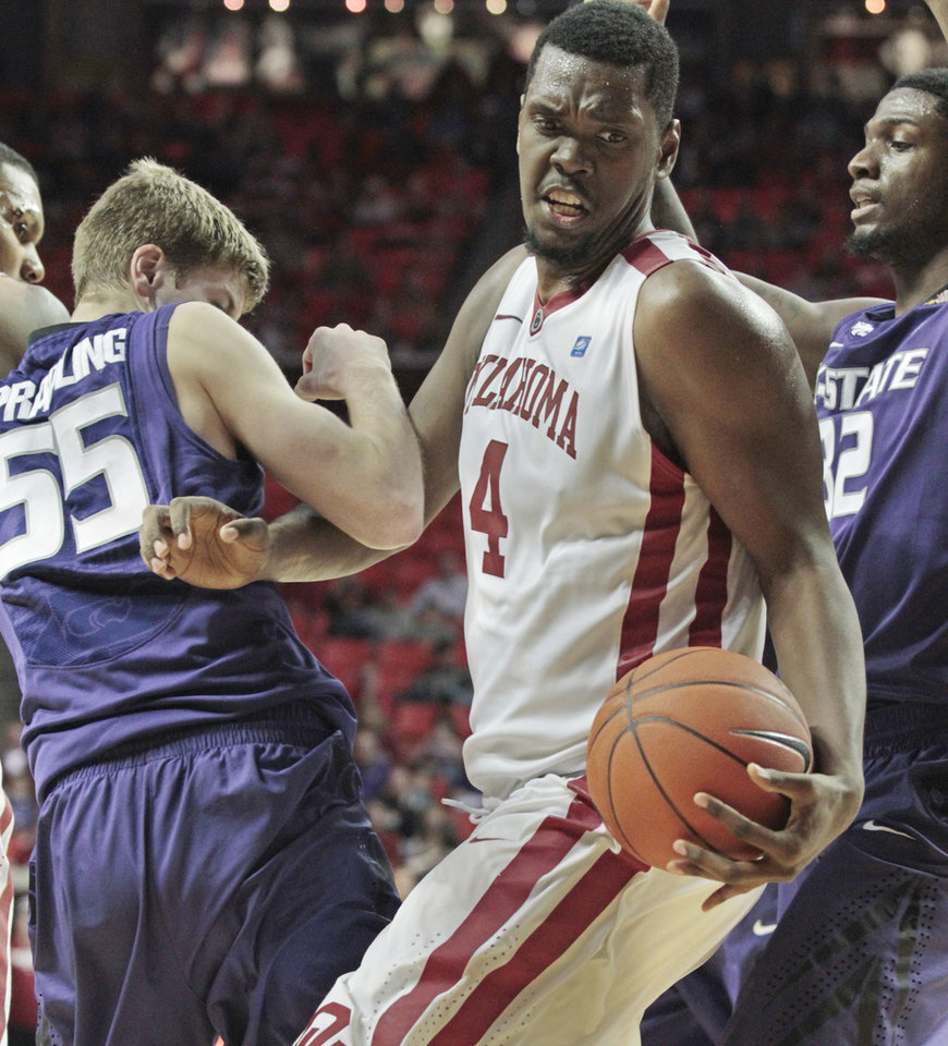 Photo - Oklahoma Sooners' Andrew Fitzgerald (4) fights for a rebound with Kansas State Wildcats' Will Spradling (55) and Jamar Samuels in the second half as the University of Oklahoma (OU) Sooners defeat the Kansas State Wildcats 82-73 in men's college basketball at the Lloyd Noble Center on Saturday, Jan. 14, 2012, in Norman, Okla.  Photo by Steve Sisney, The Oklahoman