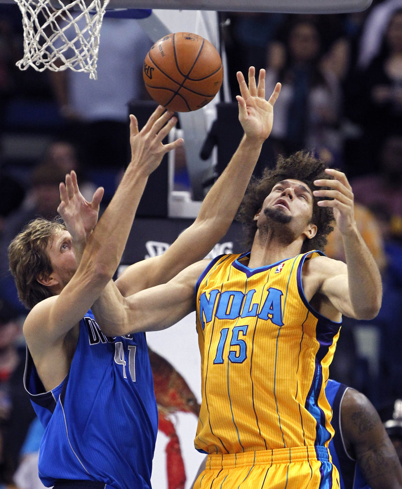 New Orleans Hornets center Robin Lopez (15) battles for a rebound against Dallas Mavericks forward Dirk Nowitzki (41) in the first half of an NBA basketball game in New Orleans, Friday, Feb. 22, 2013. (AP Photo/Gerald Herbert)