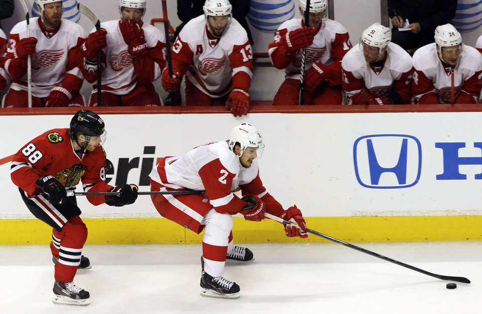 Detroit Red Wings' Brendan Smith (2) controls the puck past Chicago Blackhawks' Patrick Kane (88)  during the third period of Game 2 of the NHL hockey Stanley Cup playoffs Western Conference semifinals  in Chicago, Saturday, May 18, 2013. The Red Wings won 4-1. (AP Photo/Nam Y. Huh)