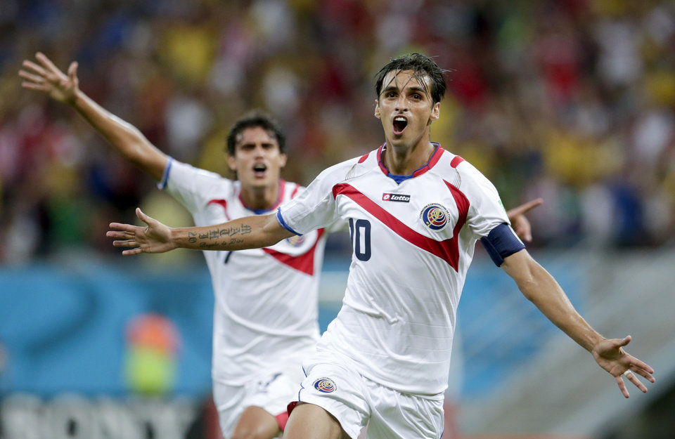 Photo - Costa Rica's Bryan Ruiz celebrates after scoring his side's first goal during the World Cup round of 16 soccer match between Costa Rica and Greece at the Arena Pernambuco in Recife, Brazil, Sunday, June 29, 2014. (AP Photo/Petr David Josek)