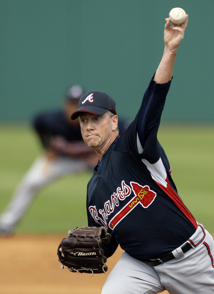Photo - FILE - In this March 1, 2008, file photo, Atlanta Braves pitcher Tom Glavine throws a pitch against the Houston Astros during the second inning of a Grapefruit League spring training baseball game in Kissimmee, Fla. Mad Dog and Glav were fixtures in the Atlanta Braves rotation for years, and now they await word on another possible honor that will keep them together: induction into the Baseball Hall of Fame. (AP Photo/David J. Phillip, File)