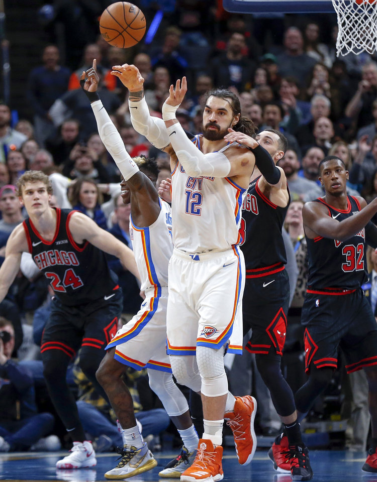 Photo - Oklahoma City's Steven Adams (12) passes the ball away from Chicago's Zach LaVine (8) after rebounding his own missed free throw in the final seconds during an NBA basketball game between the Oklahoma City Thunder and Chicago Bulls at Chesapeake Energy Arena in Oklahoma City, Monday, Dec. 16, 2019. Oklahoma City won 109-106. [Nate Billings/The Oklahoman]