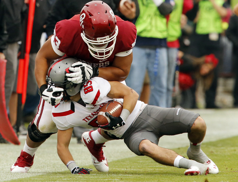 Tony Feo (53) tackles Texas Tech's Jordan Davis (85) during a college football game between the University of Oklahoma Sooners (OU) and the Texas Tech Red Raiders at Gaylord Family-Oklahoma Memorial Stadium in Norman, Okla., on Saturday, Oct. 26, 2013. Photo by Steve Sisney, The Oklahoman