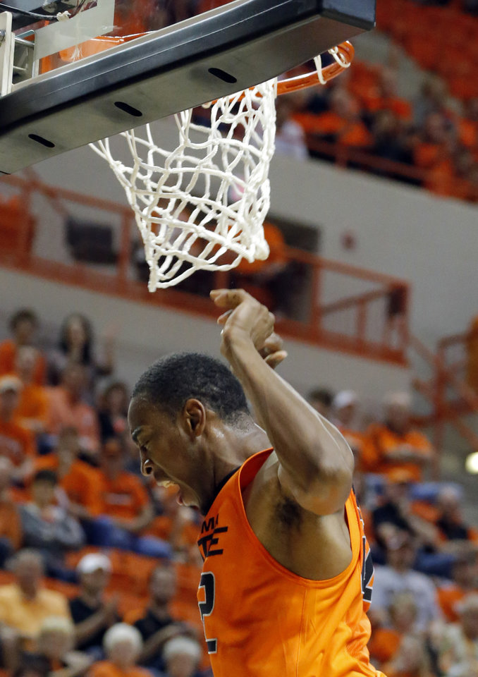 Oklahoma State's Markel Brown (22) celebrates a dunk during the men's college basketball game between Oklahoma State and UC Davis at  Gallagher-Iba Arena in Stillwater, Okla., Friday, Nov. 9, 2012. Photo by Sarah Phipps, The Oklahoman