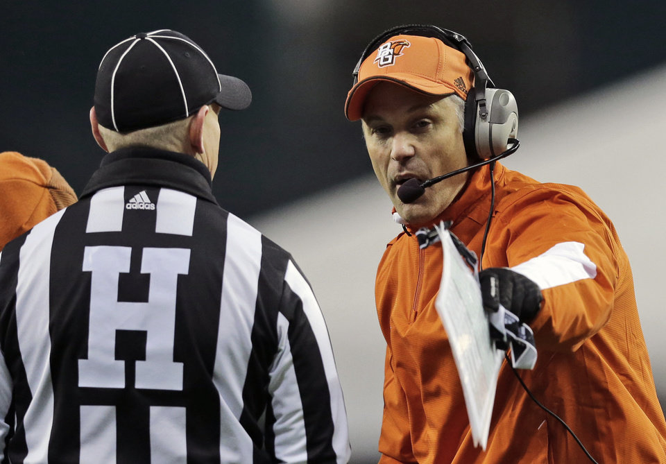 Bowling Green head coach Dave Clawson, right, talks with an official during the second half of the NCAA college football Military Bowl against San Jose State at RFK Stadium, Thursday, Dec. 27, 2012, in Washington. San Jose State won 29-20. (AP Photo/Alex Brandon)