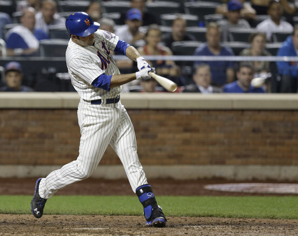Photo - New York Mets' Josh Satin hits an RBI single to tie the game during the ninth inning of the baseball game against the Arizona Diamondbacks at Citi Field, Monday, July 1, 2013, in New York. (AP Photo/Seth Wenig)