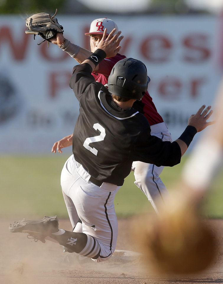 Owasso's Andrew Rosa tags out Norman North's Daniel Herron at second in the first inning in the Class 6A state baseball tournament championship game in Shawnee, Okla., Saturday, May 11, 2013. Photo by Bryan Terry, The Oklahoman
