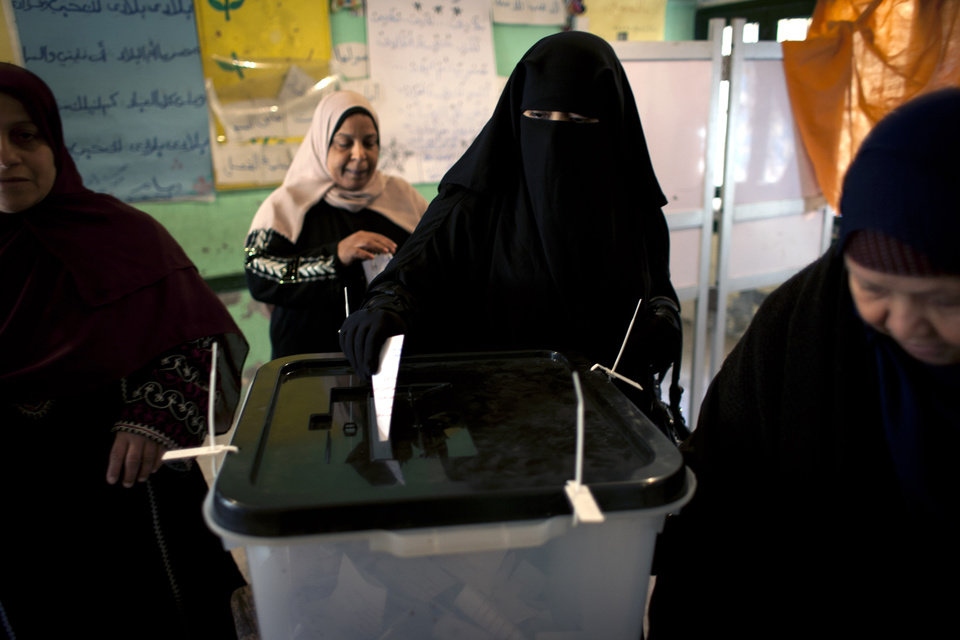 Egyptian women vote at a polling station in the second round of a referendum on a disputed constitution drafted by Islamist supporters of President Mohammed Morsi, in Giza, Egypt, Saturday, Dec. 22, 2012. (AP Photo/Nasser Nasser)