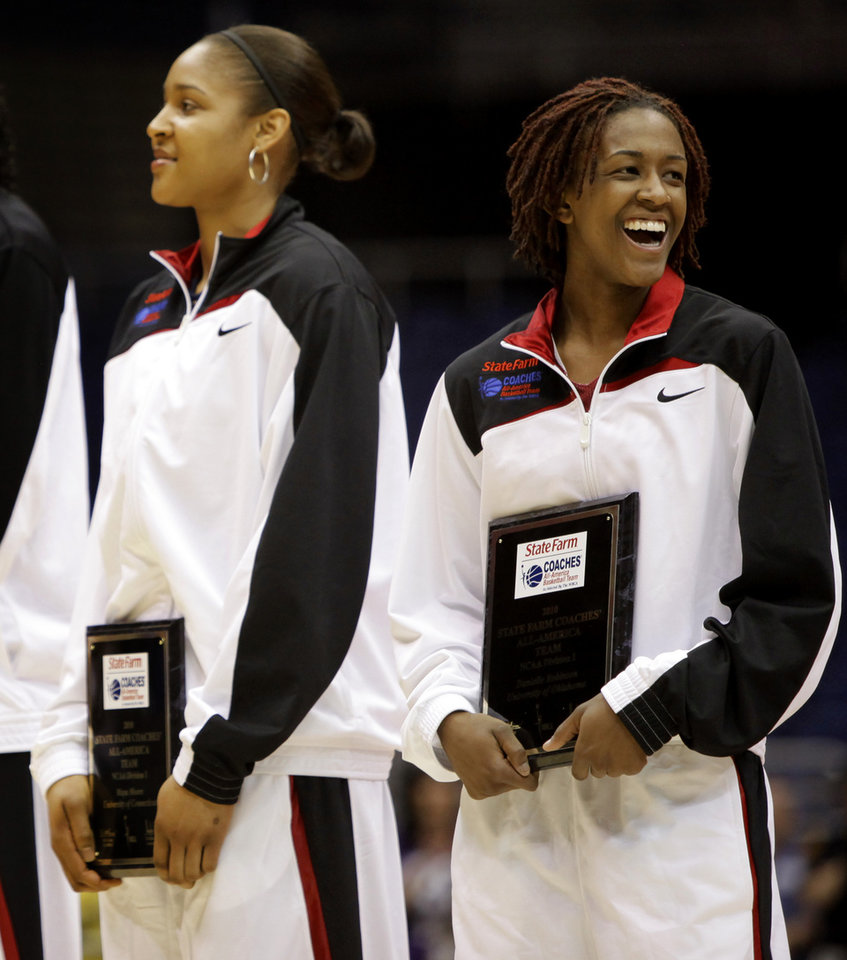 Photo - OU / WOMEN'S COLLEGE BASKETBALL / WOMEN'S NCAA TOURNAMENT: OU's Danielle Robinson smiles next to Connecticut's Maya Moore after being named to the Coaches' All-American team before the Final Four of the NCAA women's  basketball tournament in San Antonio, Texas., on Saturday, April 3, 2010.  The University of Oklahoma will play Stanford on Sunday, April 4, 2010.  Photo by Bryan Terry, The Oklahoman ORG XMIT: KOD