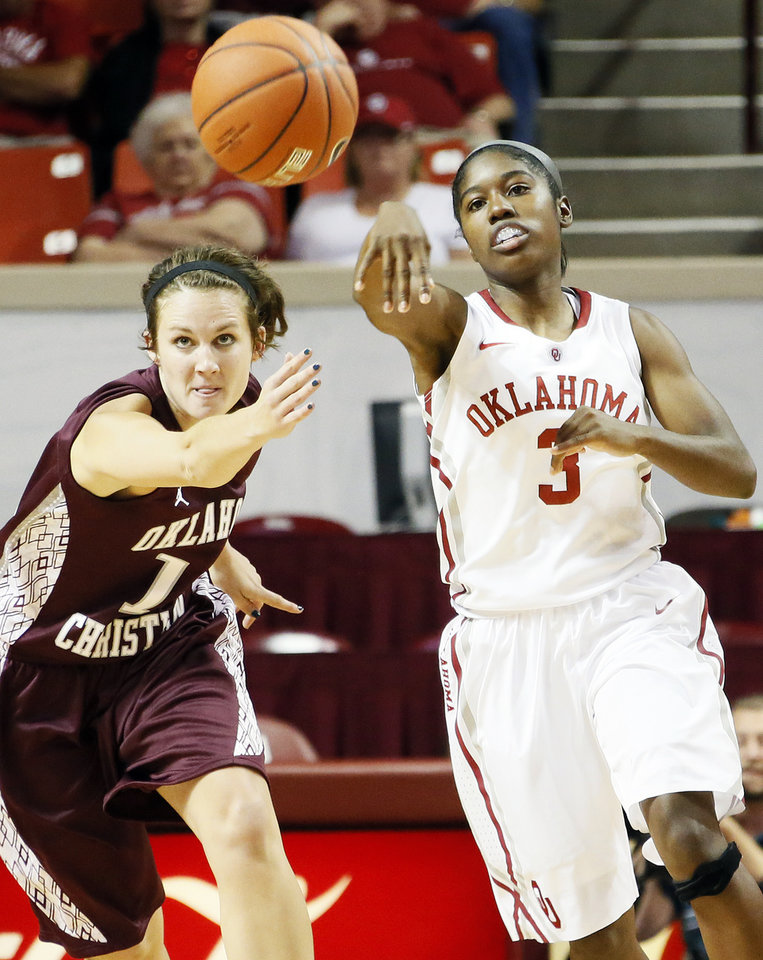 OU's Aaryn Ellenberg (3) passes the ball away from Madison Middle (10) of Oklahoma Christian during a women's college basketball exhibition game between the University of Oklahoma and Oklahoma Christian University at the Lloyd Noble Center in Norman, Okla., Thursday, Nov. 1, 2012. Photo by Nate Billings, The Oklahoman