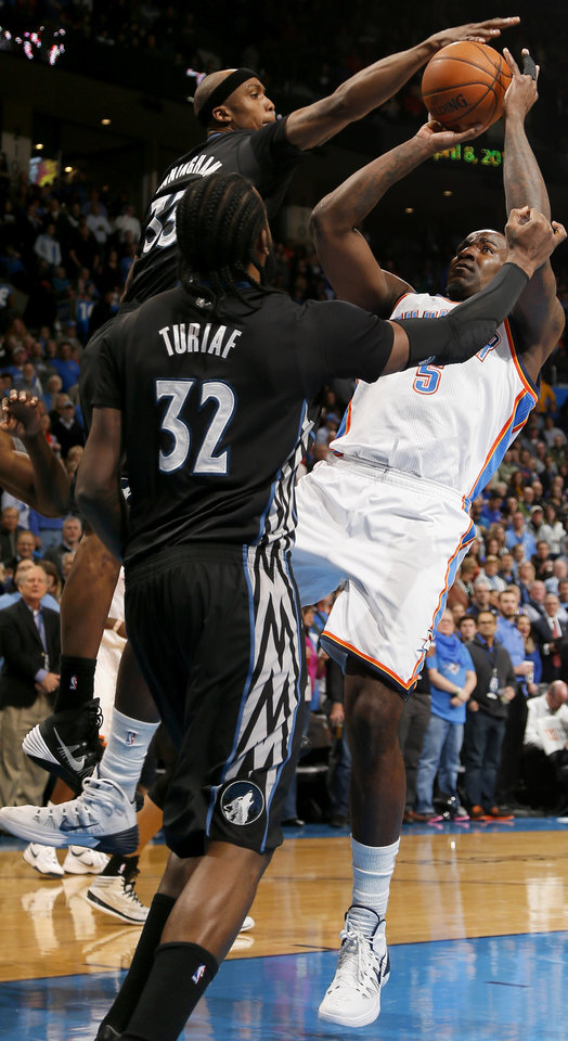 Photo - Oklahoma City's Kendrick Perkins (5) has his shot blocked by Minnesota's Dante Cunningham (33) as Ronny Turiaf watches during an NBA basketball game between the Oklahoma CIty Thunder and the Minnesota Timberwolves at Chesapeake Energy Arena in Oklahoma City, Wednesday, Feb. 5, 2014. Photo by Bryan Terry, The Oklahoman