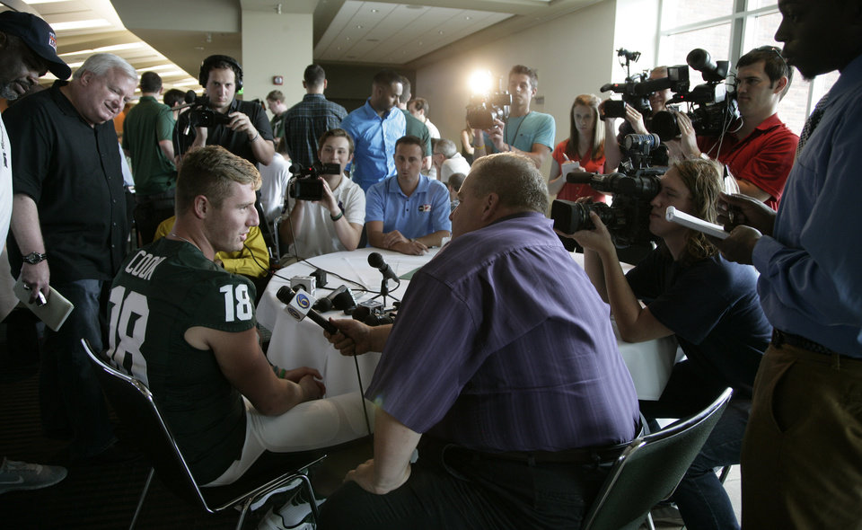 Photo - Michigan State quarterback Connor Cook (18) is interviewed during the team's NCAA college football media day, Monday, Aug. 4, 2014, in East Lansing, Mich. (AP Photo/Al Goldis)
