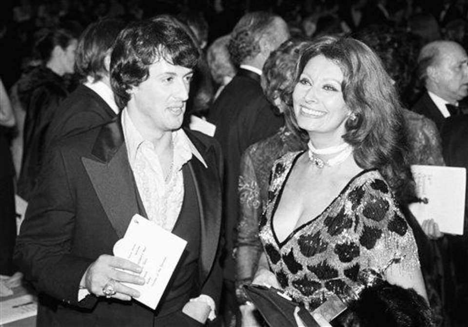 Sylvester Stallone, star and writer of the movie ?Rocky,? and Sophia Loren, named Female World Film Favorite, talk at the annual Golden Globes Awards in Los Angeles, Jan. 30, 1977. ?Rocky? was named last year?s best dramatic motion picture. (AP Photo)