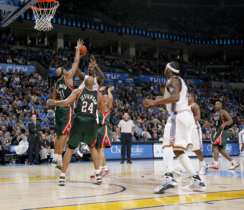 Jeff Green of Oklahoma City shoots the ball over Charlie Villanueva, left, and Richard Jefferson of Milwaukee during the opening NBA basketball game between the Oklahoma City Thunder and the Milwaukee Bucks at the Ford Center in Oklahoma City, Wednesday, October 29, 2008.  BY BRYAN TERRY, THE OKLAHOMAN