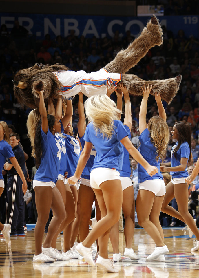 Photo - Rumble the Bison performs with the Thunder Girls during an NBA basketball game between the Oklahoma City Thunder and the San Antonio Spurs at Chesapeake Energy Arena in Oklahoma City, Thursday, April 3, 2014. Oklahoma City won 106-94. Photo by Bryan Terry, The Oklahoman
