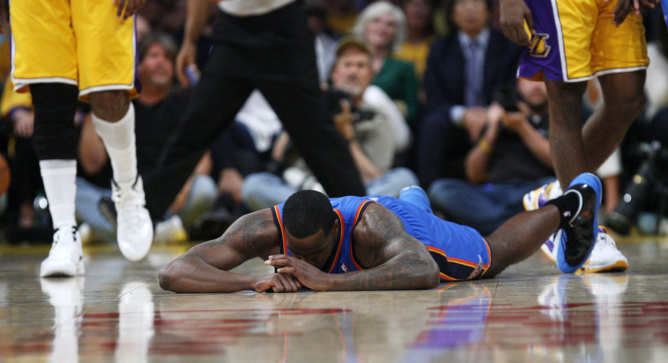 Oklahoma City's Kendrick Perkins (5) lies on the court after being called for an offensive foul in the fourth quarter during Game 3 in the second round of the NBA basketball playoffs between the L.A. Lakers and the Oklahoma City Thunder at the Staples Center in Los Angeles, Saturday, May 19, 2012. Photo by Nate Billings, The Oklahoman