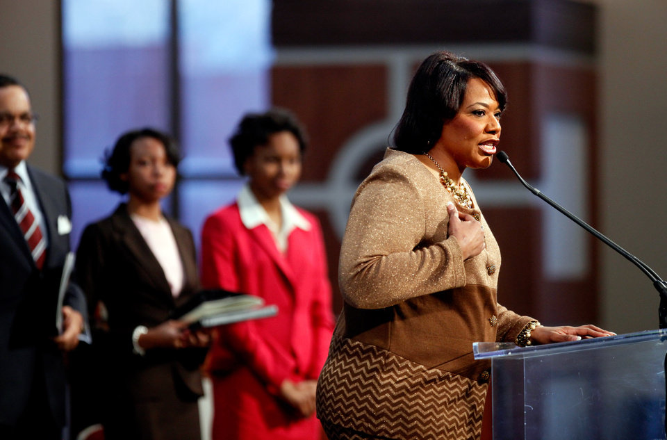 Photo - Dr. Bernice King, daughter of Dr. Martin Luther King Jr., right, speaks during the annual Dr. Martin Luther King Jr. holiday commemorative service at the Ebenezer Baptist Church, Monday, Jan. 21, 2013, in Atlanta. The nation will honor civil rights leader Martin Luther King Jr. on Monday, the same day as it celebrates the inauguration of the first black president to his second term. (AP Photo/David Goldman)