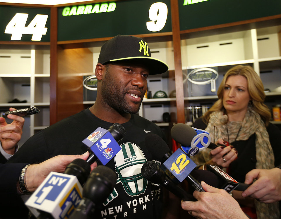Photo - New York Jets quarterback David Garrard, left, talks to reporters during a locker room availability at the team's NFL practice practice facility in Florham Park, N.J., Thursday, May 2, 2013. The Jets may have cut Tim Tebow but their situation at quarterback is far from settled. New general manager John Idzik says Gerrard, Mark Sanchez, Greg McElroy, Matt Simms and second-round draft pick Geno Smith are all candidates to be the starter. (AP Photo/Rich Schultz)