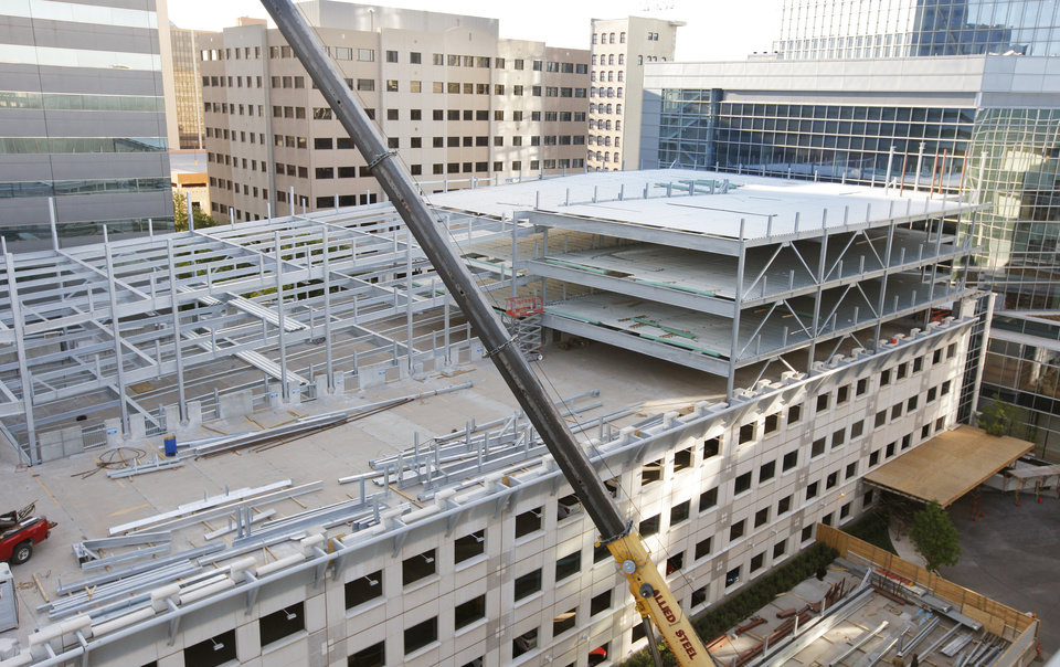 Photo -  Steel beams are going up on an expansion to the City Center parking garage at Park and Harvey Avenues. Photo by Paul B. Southerland, The Oklahoman   PAUL B. SOUTHERLAND -  PAUL B. SOUTHERLAND