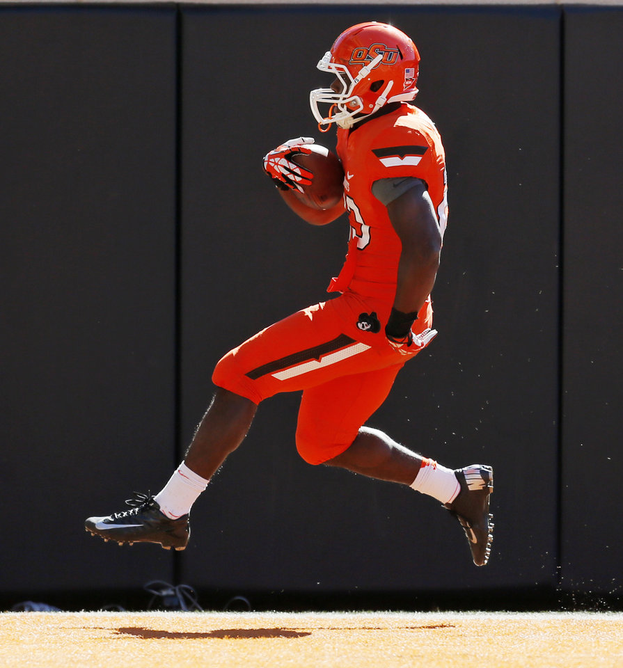 Oklahoma State\'s Rennie Childs (23) rushes for a touchdown in the fourth quarter during a college football game between the Oklahoma State University Cowboys (OSU) and the Texas Christian University Horned Frogs (TCU) at Boone Pickens Stadium in Stillwater, Okla., Saturday, Oct. 19, 2013. OSU won, 24-10. Photo by Nate Billings, The Oklahoman