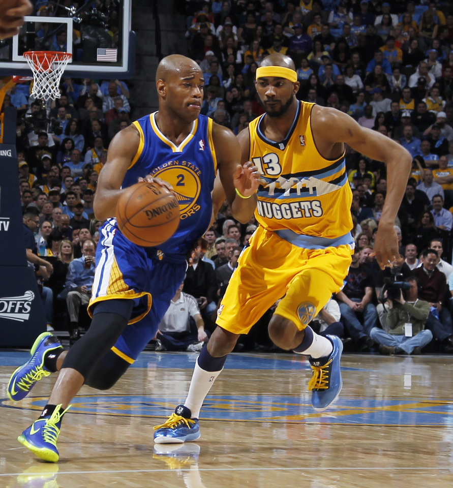 Photo - Golden State Warriors guard Jarrett Jack, left, works the ball inside past Denver Nuggets forward Corey Brewer in the first quarter of Game 2 of the teams' NBA first-round playoff series in Denver on Tuesday, April 23, 2013. (AP Photo/David Zalubowski)