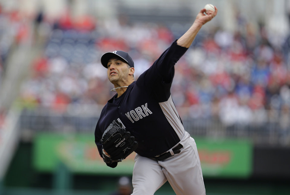 Photo - New York Yankees starting pitcher Andy Pettitte throws during the first inning of an exhibition baseball game against the Washington Nationals at Nationals Park Friday, March 29, 2013, in Washington. (AP Photo/Alex Brandon)