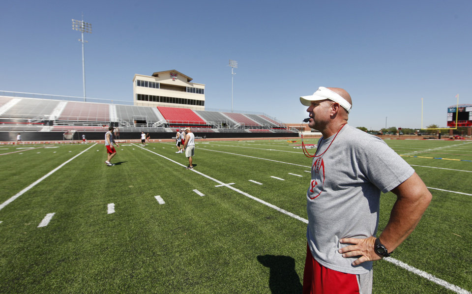 HIGH SCHOOL FOOTBALL PRACTICE: Coach Todd Wilson leads drills during practice in the new stadium in Yukon, Tuesday, August 08, 2011. Photo by Steve Gooch ORG XMIT: KOD