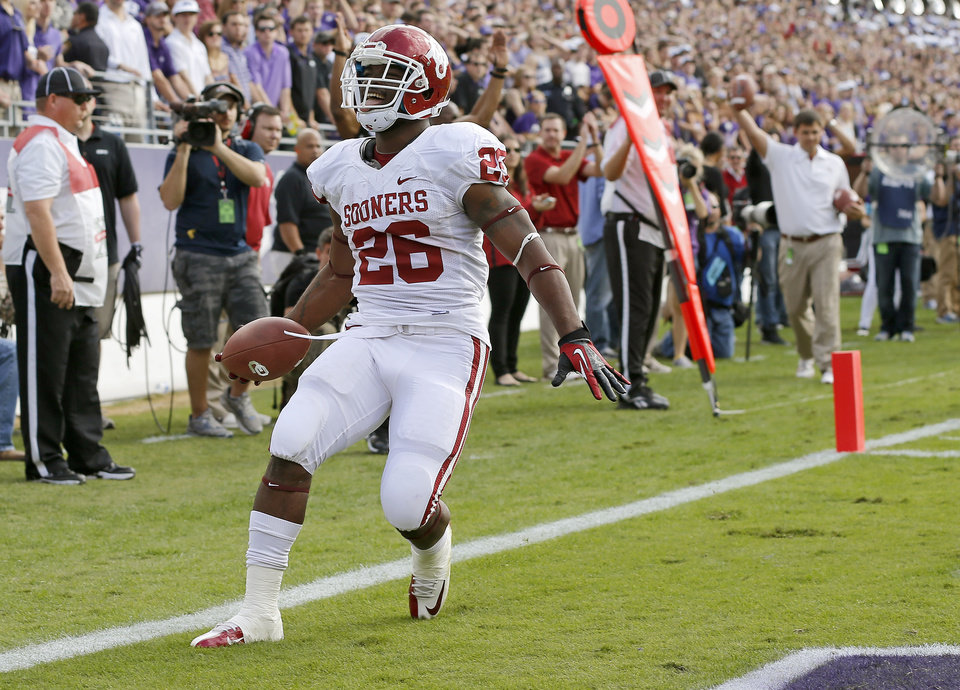 Oklahoma\'s Damien Williams (26) scores a touchdown during a college football game between the University of Oklahoma Sooners (OU) and the Texas Christian University Horned Frogs (TCU) at Amon G. Carter Stadium in Fort Worth, Texas, Saturday, Dec. 1, 2012. Oklahoma won 24-17. Photo by Bryan Terry, The Oklahoman