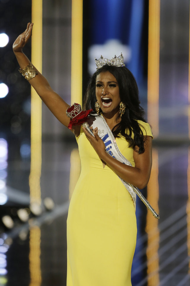 Photo - Miss New York Nina Davuluri walks down the runway after winning the the Miss America 2014 pageant, Sunday, Sept. 15, 2013, in Atlantic City, N.J. (AP Photo/Mel Evans)