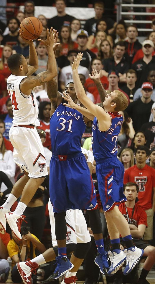Photo - Texas Tech's Robert Turner (14) is defended by Kansas' Jamari Traylor (31) and Conner Frankamp (23) during their NCAA college basketball game in Lubbock, Texas, Tuesday, Feb, 18, 2014. (AP Photo/Lubbock Avalanche-Journal, Stephen Spillman)