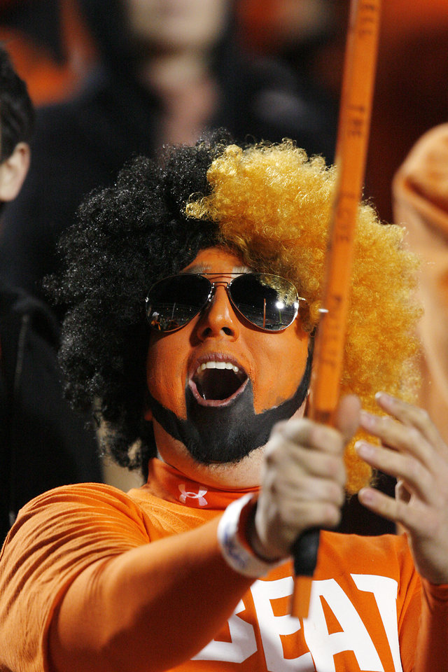 Photo - BEDLAM / FACE PAINT / PAINTING: Oklahoma State fan Alex Belitz cheers during the pre-game of the college football game between the University of Oklahoma Sooners (OU) and Oklahoma State University Cowboys (OSU) at Boone Pickens Stadium on Saturday, Nov. 29, 2008, in Stillwater, Okla.    STAFF PHOTO BY CHRIS LANDSBERGER  ORG XMIT: KOD
