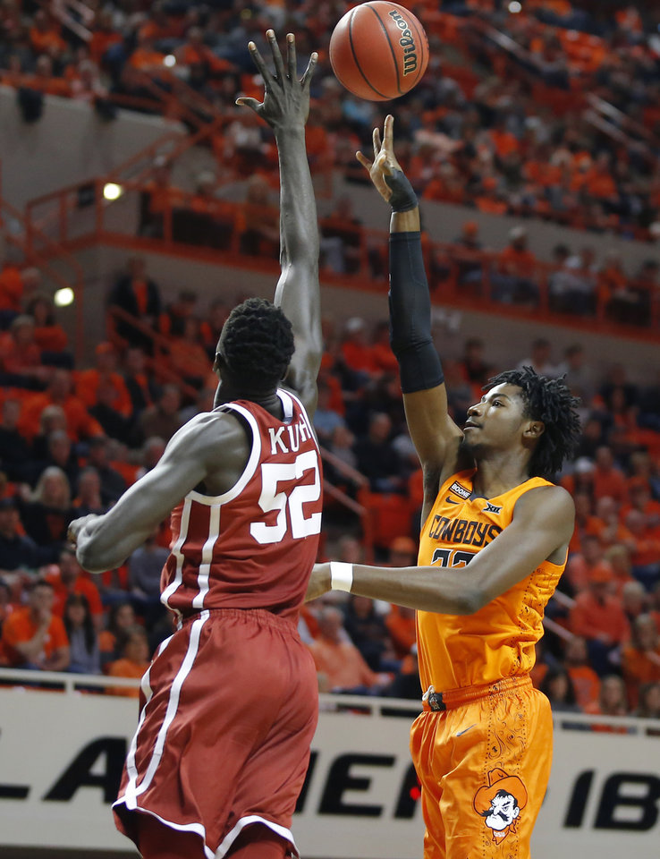 Photo - Oklahoma State's Kalib Boone (22) shoots a basket over Oklahoma's Kur Kuath (52) during an NCAA men's Bedlam basketball game between the Oklahoma State University Cowboys (OSU) and the University of Oklahoma Sooners (OU) at Gallagher-Iba Arena in Stillwater, Okla., Saturday, Feb. 22, 2020. [Bryan Terry/The Oklahoman]