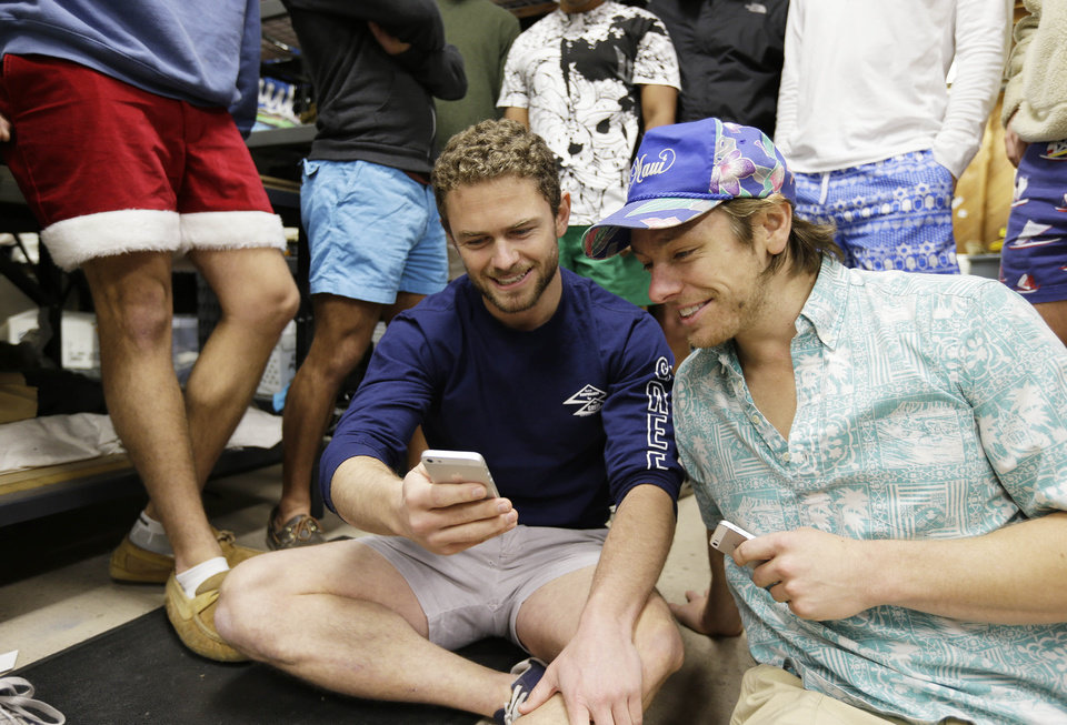 Photo - In this photo taken Wednesday, Dec. 4, 2013, co-founders Tom Montgomery, left, and Preston Rutherford, right, review Instagram performances while surrounded by co-workers at the headquarters of Chubbies Shorts in San Francisco.  Chubbies uses Facebook for marketing tools like videos that users will share with their friends. It uses Twitter for conversations with customers, and posts photos on Instagram to create buzz about their products. (AP Photo/Eric Risberg)