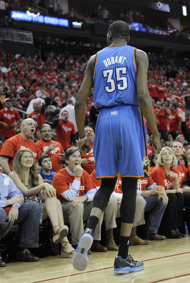Photo - Oklahoma City Thunder's Kevin Durant (35) talks with Houston Rockets fans in the first quarter of Game 6 in a first-round NBA basketball playoff series Friday, May 3, 2013, in Houston. (AP Photo/Pat Sullivan)