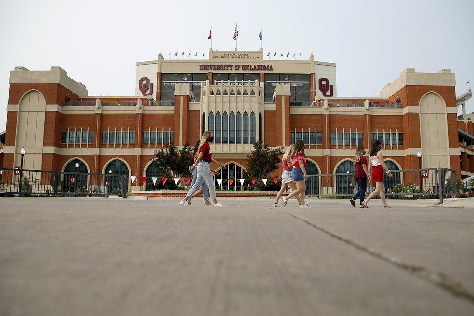 Photo - Fans walk past Gaylord Family-Oklahoma Memorial Stadium before a college football game between the University of Oklahoma Sooners (OU) and Missouri State in Norman, Okla., Saturday, Sept. 12, 2020. [Bryan Terry/The Oklahoman]